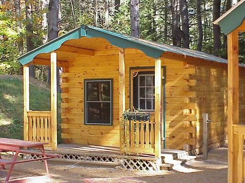 Log camp cabins log cabin kits gallery photos for Camping cabin kits